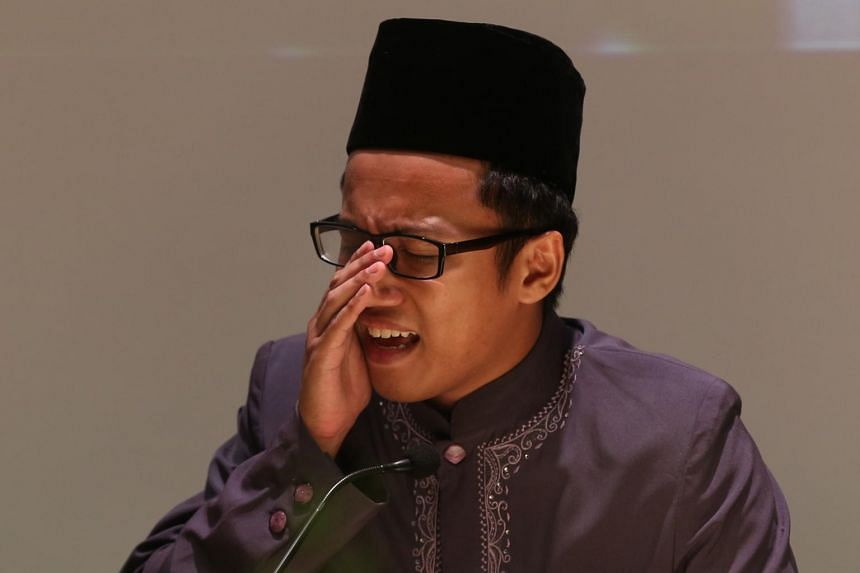 Mr Ahmad Daniyal Bin Mohd Rizal, winner of the Adult (Male) category recites the Quran at the National Quranic Recitations Competition 2016 on April 24, 2016.
