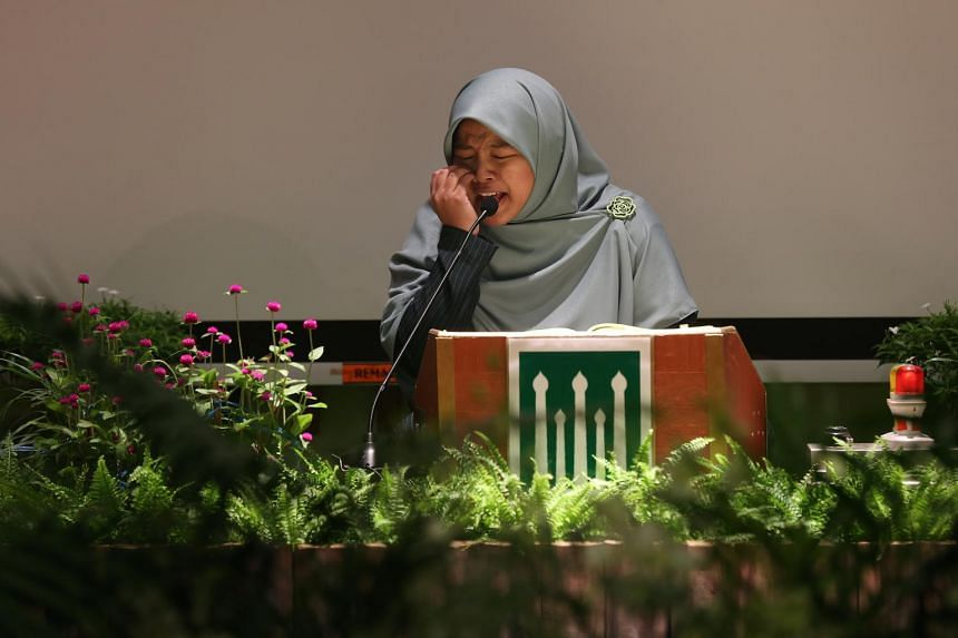 Ms Nurul 'Izzah Binti Kahmsani, 31, winner of the Adult (Female) category recites the Quran at the National Quranic Recitations Competition 2016 on April 24, 2016.