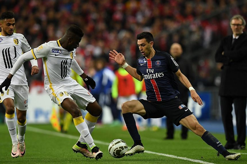 Paris Saint-Germain's midfielder Javier Pastore (right) vies with Lille's midfielder Ibrahim Amadou.