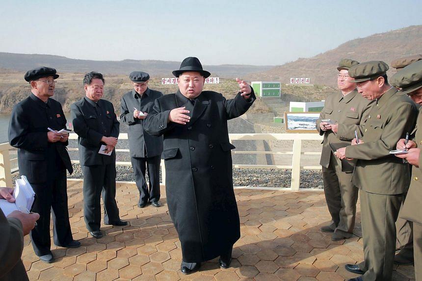 An undated photo of North Korean leader Kim Jong Un visiting the Paektusan Hero Youth Power Station No. 3.