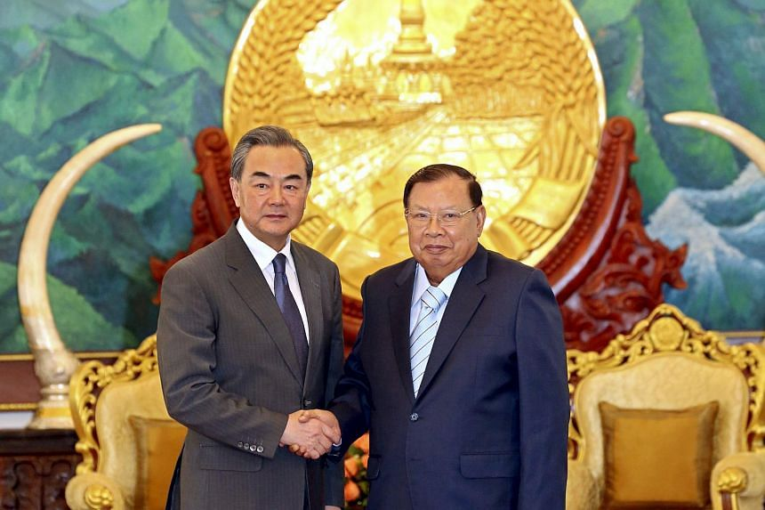 Chinese Foreign Minister Wang Yi (left) with newly elected Laos President Bounnhang Vorachit during a meeting in Vientiane, Laos, on April 23, 2016.