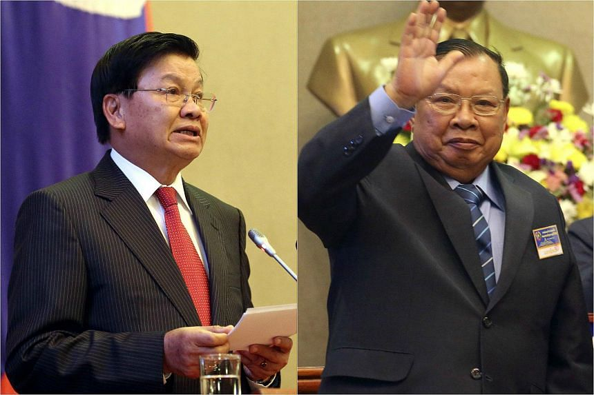 Laos' newly elected Prime Minister Thongloun Sisoulith (left) and head of state Bounnhang Vorachit.