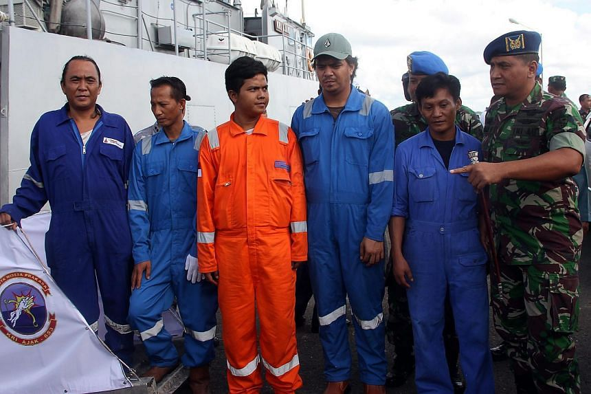 Five Indonesian sailors who survived an attempted hijacking arrive at a port in Tarakan, Borneo Island, Indonesia on April 23, 2016.