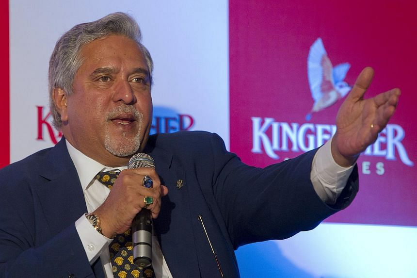 Former airline chairman Vijay Mallya speaks to the media during a news conference in Mumbai.