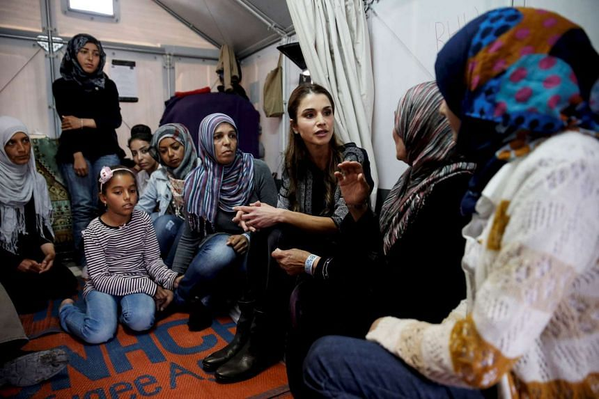 Queen Rania of Jordan meeting Syrian refugee women during her visit to the Kara Tepe refugee camp on the Greek island of Lesbos, on April 25, 2016.
