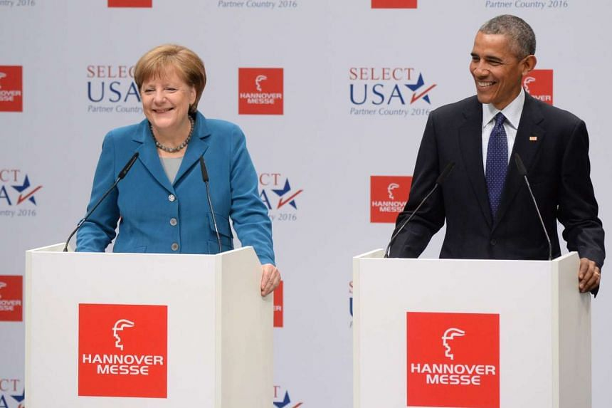 German Chancellor Angela Merkel (left) and US President Barack Obama speaking before a tour of the Hannover Messe trade fair in Hanover, Germany, on April 25, 2016.