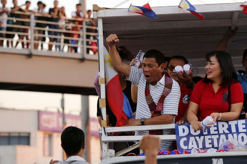 Filipino presidential candidate Rodrigo Duterte (centre) gestures during an election campaign rally in Quezon city, Philippines on April 23, 2016.