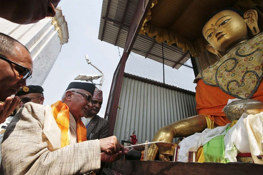 Nepalese Prime Minister Khadga Prasad Sharma Oli attends a Puja ritual ceremony at Swayambhunath Temple, to mark Nepal's reconstruction.