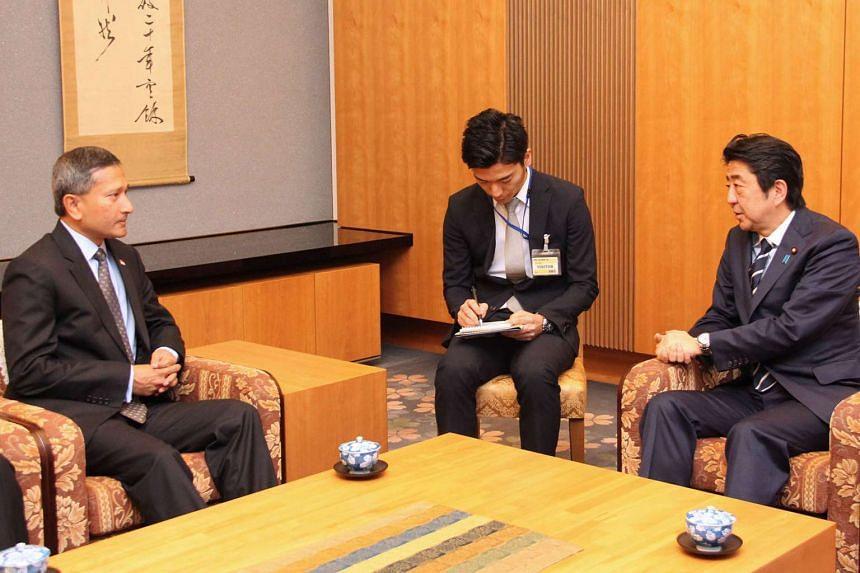 Singapore Foreign Minister Vivian Balakrishnan (left) speaking with Japanese Prime Minister Shinzo Abe in Tokyo on April 25, 2016.