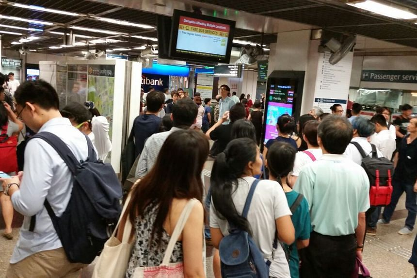 Passengers waiting at City Hall MRT on April 25, 2015 after train services were disrupted.
