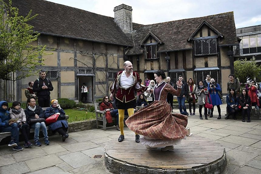 Tourists watch performers at the house where William Shakespeare was born during celebrations to mark the 400th anniversary of his death in Stratford- Upon-Avon last Saturday.
