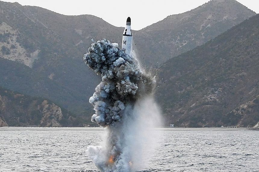 North Korea fired a ballistic missile from a submarine off its east coast on Saturday in Pyongyang's latest show of military might.