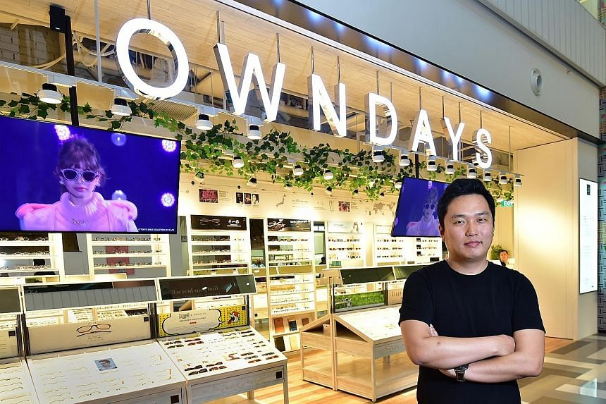Mr Umiyama, managing director of Owndays Singapore, outside the chain's new store in Tiong Bahru Plaza. He attributes its success here to a simple price structure and quick service as compared to local shops. Many Owndays customers can collect their