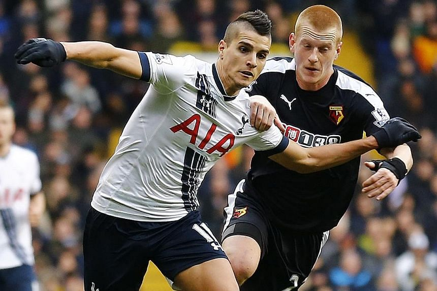 Tottenham's Erik Lamela holding off the challenge of Watford's Ben Watson during a Premier League meeting between their two sides in February. The Argentinian has come a long way, from failing to impress in his debut season, to being part of an attac