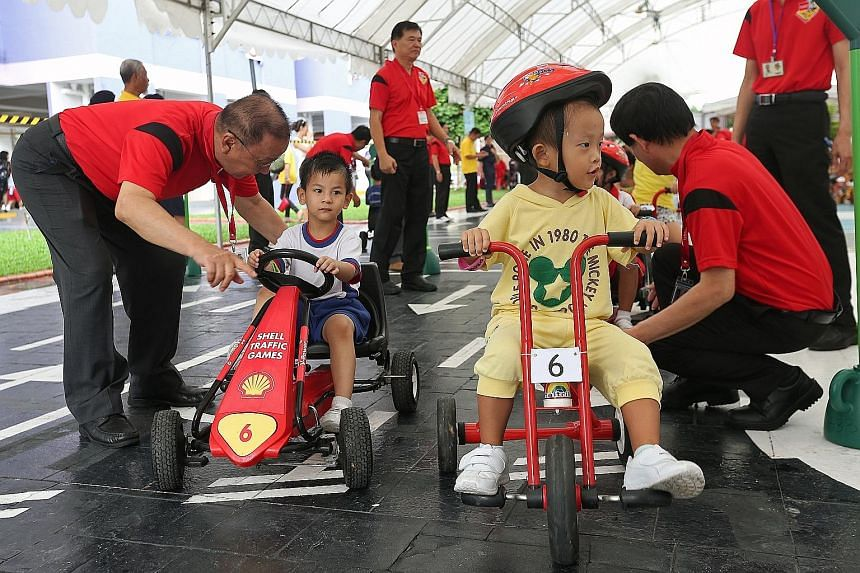 Children taking part in the road-safety event in Ang Mo Kio yesterday. The old and the young are among the most vulnerable road users.