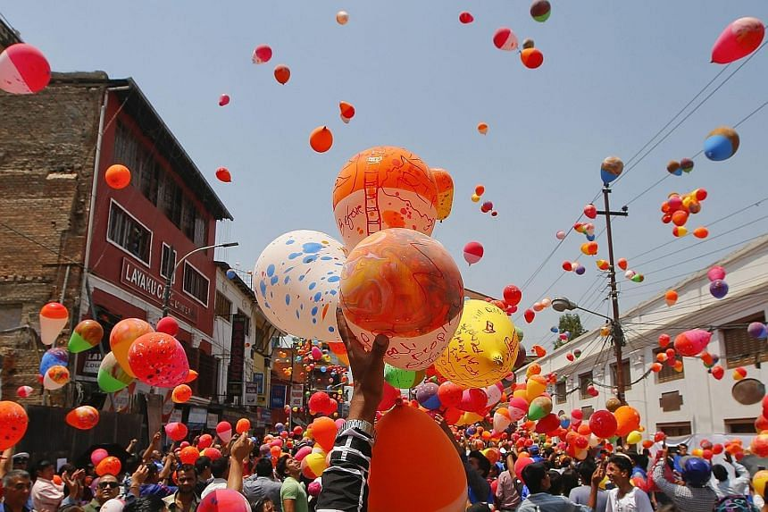People in Nepal releasing balloons at Kathmandu Durbar Square last Saturday in memory of the 9,000 people killed in an earthquake that hit the country a year ago. Thousands of people gathered at the tourist landmark, which was damaged during the 7.8