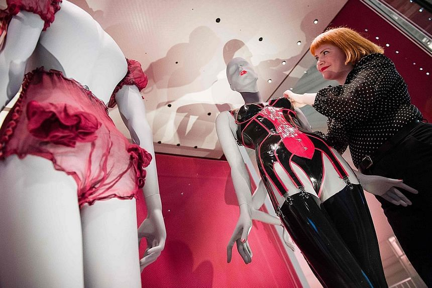 A mannequin displaying a bra, corset, stockings and thong by Robin Archer for House Of Harlot at the Undressed: A Brief History Of Underwear exhibition.