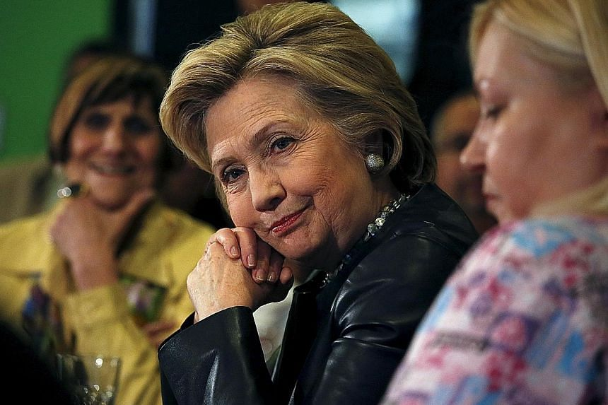 Mrs Clinton at a conversation with residents in Connecticut on Saturday. She is likely to make her pick for a partner soon after the Republican ticket is known.