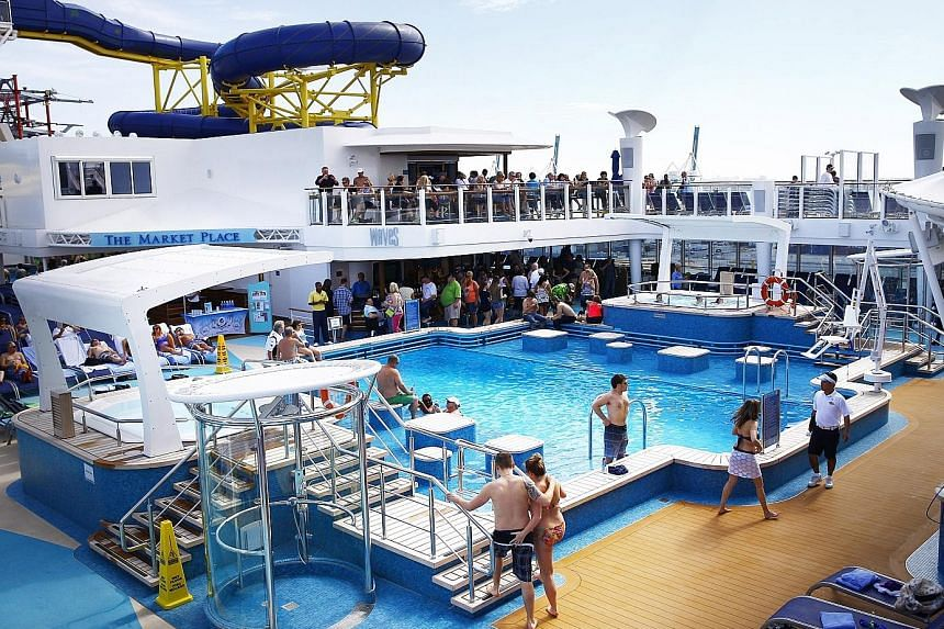 (Top) One of many public pool areas aboard the Norwegian Escape and (above) a private pool in the Haven, a separate accommodation area for wealthy guests aboard the cruise ship.