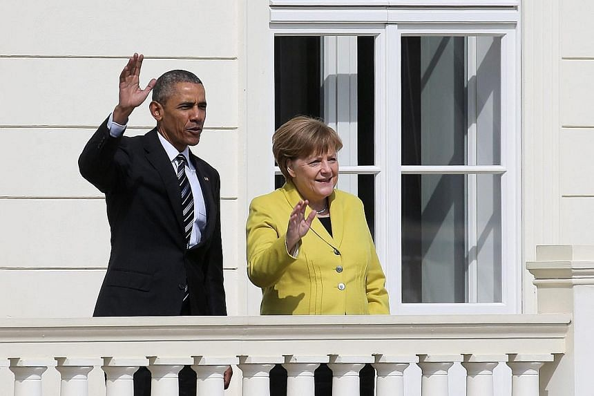 """Mr Obama and Dr Merkel at the Herrenhausen Palace in Hanover yesterday. Mr Obama, who is on his fifth and final official trip to Germany, called Dr Merkel """"one of my closest partners and also a friend""""."""