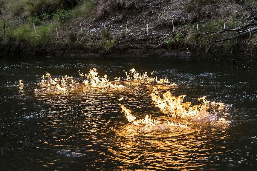 A photo from the New South Wales Greens Party showing methane gas on fire along the Condamine River in Queensland, about 220km west of Brisbane. Greens MP Jeremy Buckingham used a kitchen lighter to ignite bubbles of methane there to draw attention t
