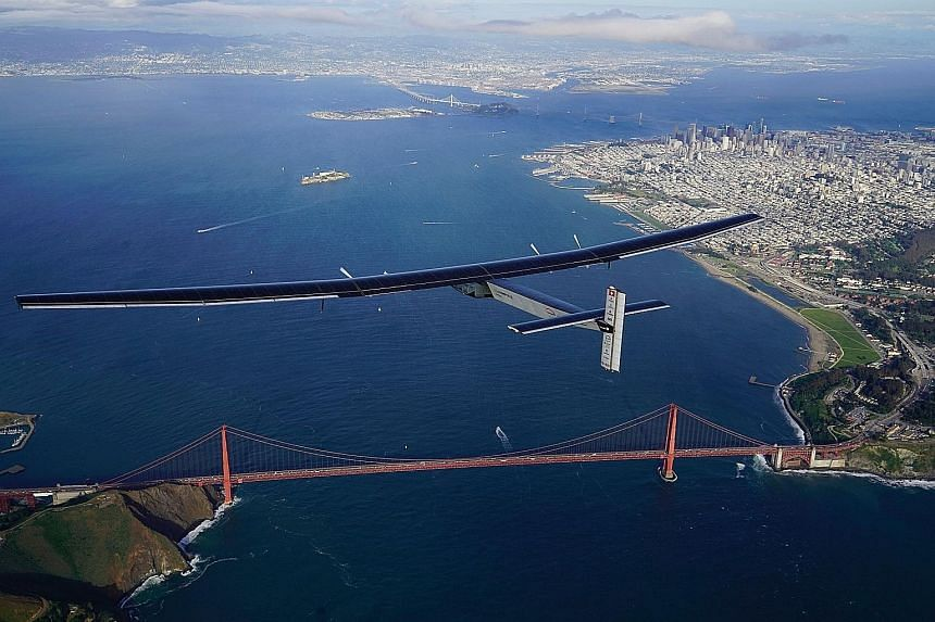 Solar Impulse 2, a solar-powered plane piloted by Swiss adventurer Bertrand Piccard, flying over the Golden Gate Bridge in San Francisco last Saturday, after a flight from Hawaii. The plane took off last Thursday and flew non-stop for three days, cov