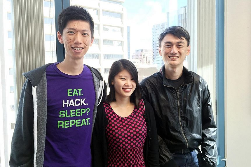 Co-founders of KeyReply (from left) Max Xu, Carylyne Chan and Spencer Yang. The firm designs AI chatbots for online service providers. The bots respond to customer chat enquiries and requests. Banners with distinctly Singaporean messages decorate the