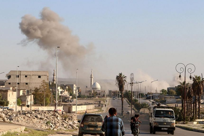 Smoke rises after an airstrike in the rebel held area of old Aleppo, Syria.