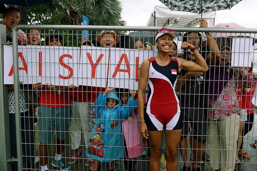 Saiyidah Aisyah Mohamed Rafa'ee celebrating with her supporters after winning a bronze medal in the women's single sculls light (1,000m) final held at the Marina Channel on June 14, 2015.