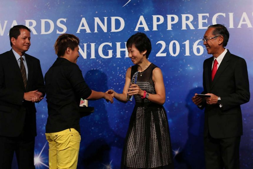 Minister for Culture, Community and Youth Grace Fu (second from right) giving swimmer Tao Li her Female Athlete of the Year (Swimming) award at the event on April 24, 2016. With them are Sport Singapore chairman Richard Seow (left) and Singapore Swim