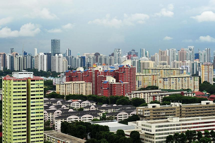 The CBD skyline, showing the skyscrapers in the city centre, as well as HDB flats and private condominiums.