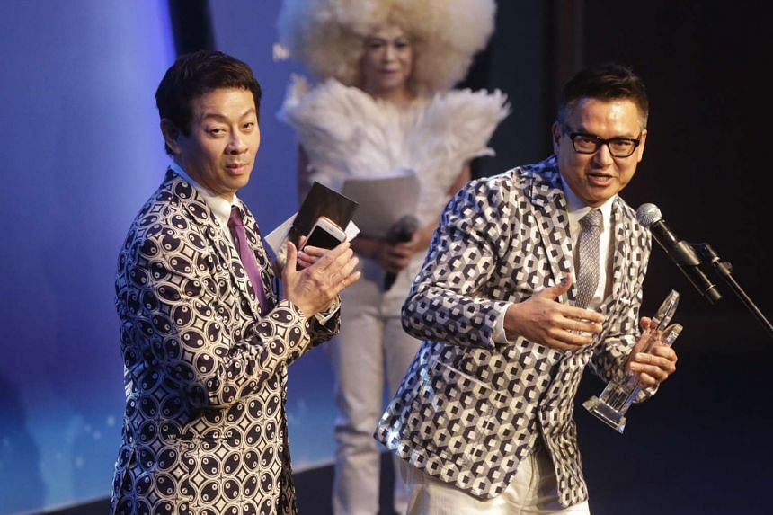Directors Glen Goei (right) and Ivan Heng (left) giving a thank you speech after receiving the Best Director Award at the M1-The Straits Times Life! Theatre Awards 2016 on April 25, 2016.