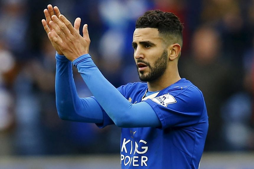 Leicester City's Riyad Mahrez applauds the fans after his team's 4-0 win over Swansea City.