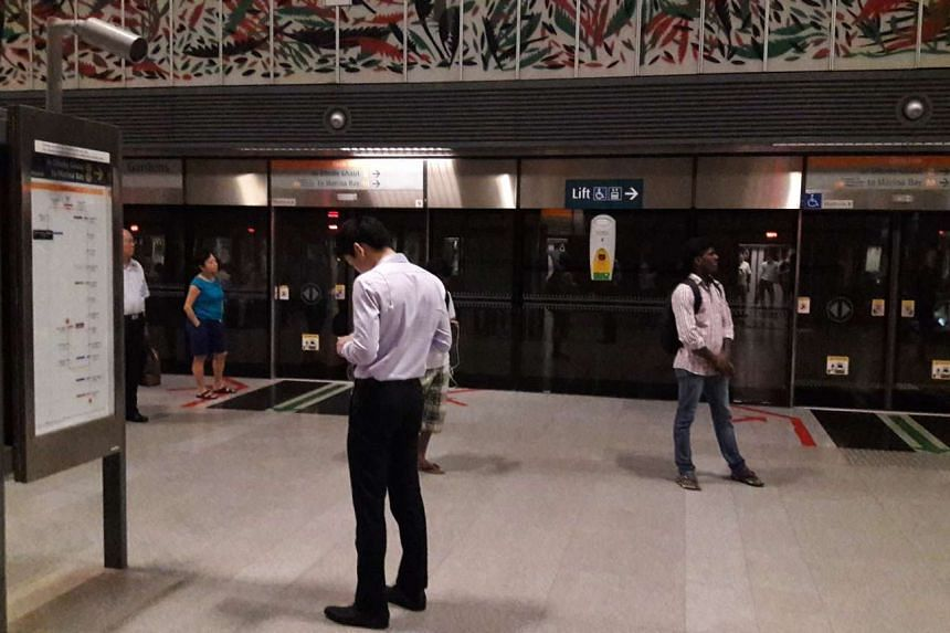 Commuters waiting inside Botanic Gardens MRT station, after a power fault caused service to be suspended, on April 25, 2016.