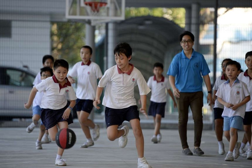 Pupils at Keming Primary School's student care centre enjoying a game of basketball.