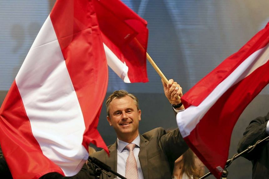 Austrian far right Freedom Party (FPOe) presidential candidate Norbert Hofer waves with Austrian flags during a rally in Vienna.