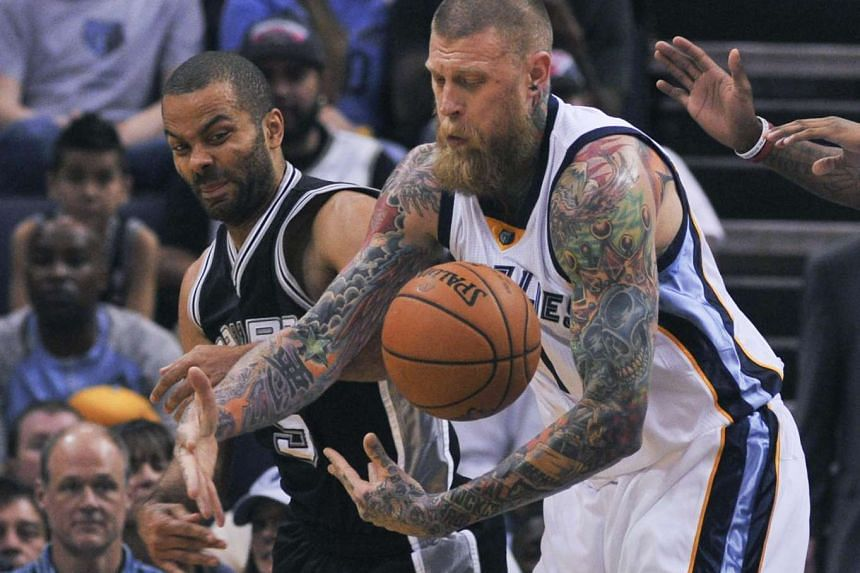 Memphis Grizzlies forward Chris Andersen (7) steals the ball from San Antonio Spurs guard Tony Parker (9) in Sunday's NBA playoff match.