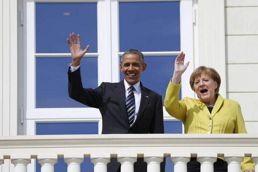 US President Barack Obama (left) and German Chancellor Angela Merkel stand on a balcony at the Herrenhausen Palace in Hanover on Sunday (April 24).