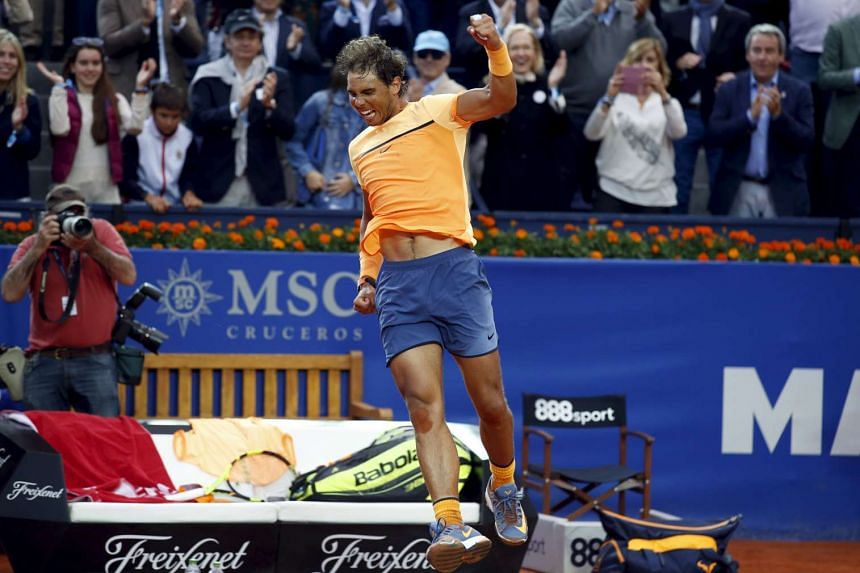Rafael Nadal of Spain jumps after winning the Barcelona Open on Sunday (April 24).