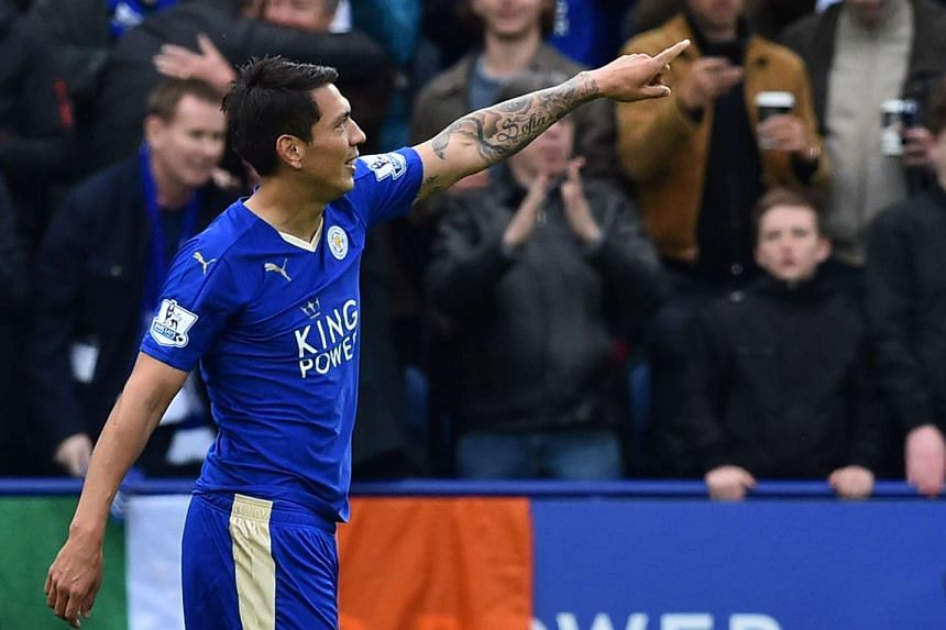 Leicester City's Argentinian striker Leonardo Ulloa celebrates scoring his second goal on Sunday (April 24).