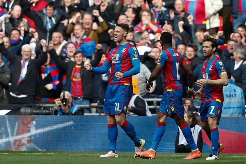 Crystal Palace's Connor Wickham (left) celebrates scoring their second goal on Sunday (April 24).