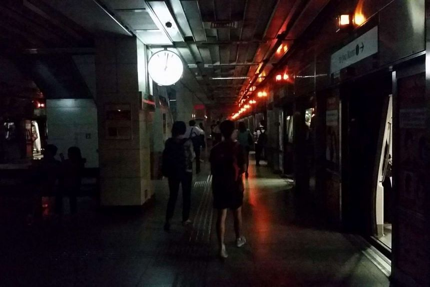 People walking in the dark at Tiong Bahru MRT on April 25, 2016.
