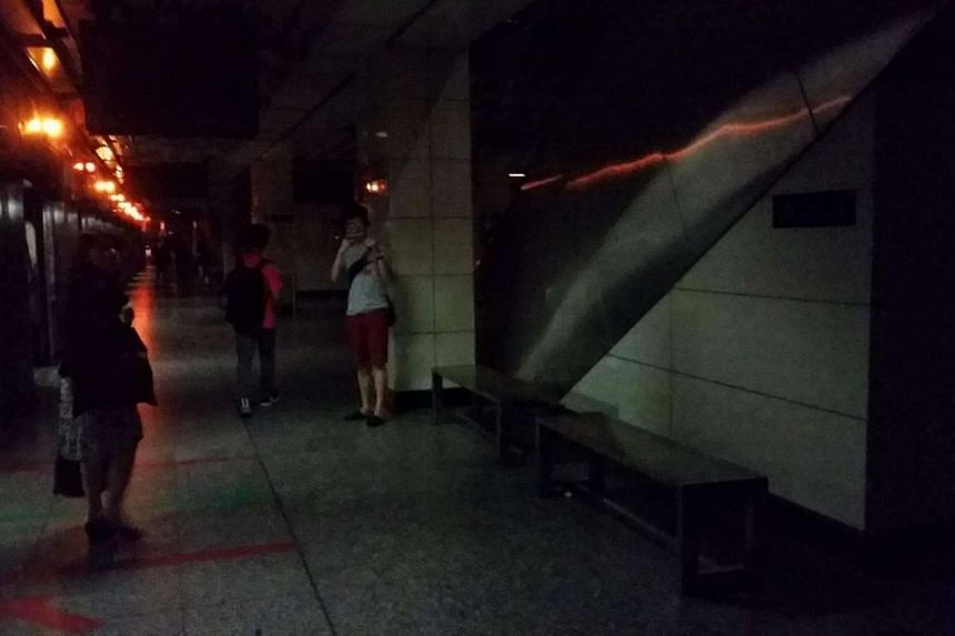 People walking in the dark at Tiong Bahru Station on April 25, 2016.