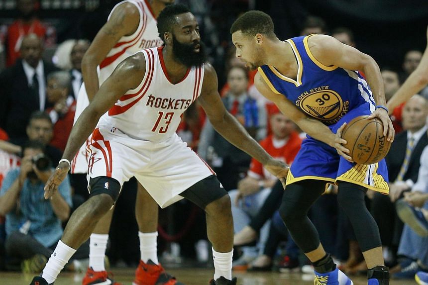 Stephen Curry #30 of the Golden State Warriors looking to drive on James Harden #13 of the Houston Rockets on April 24, 2016 in Houston, Texas.