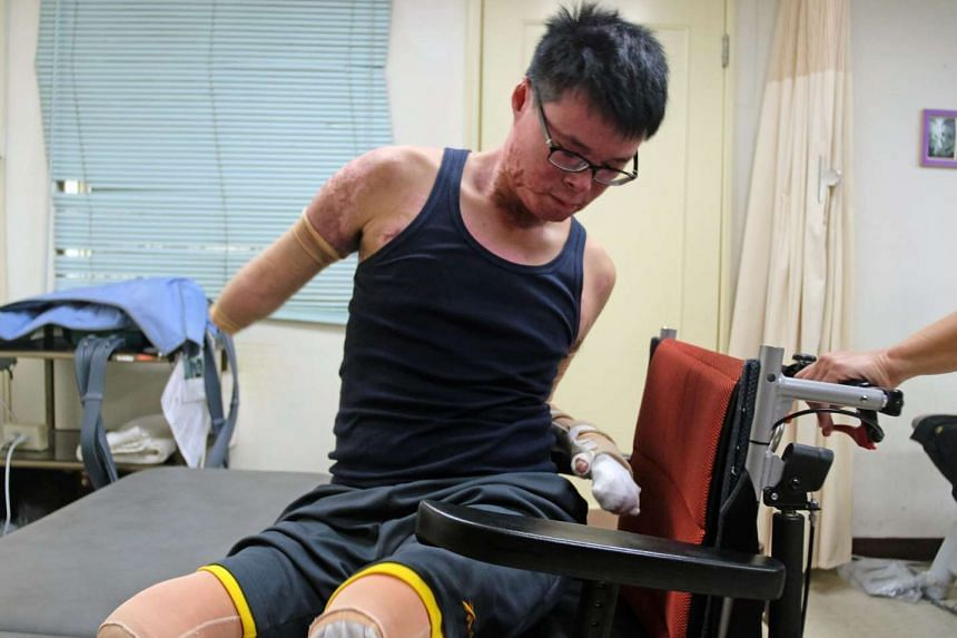Mr Huang Po-wei, an amputee who survived the 2015 New Taipei City water park explosion, working out during a rehabilitation session at a recovery centre in Taipei on April 21, 2016.