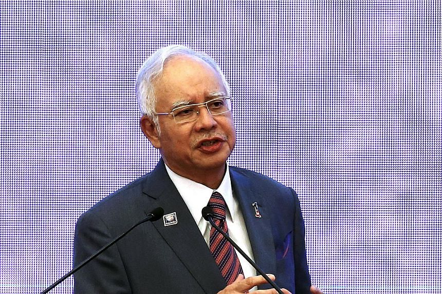 """Malaysian Prime Minister Najib Razak said that the country faces an """"uphill battle"""" to become a developed nation in the next five years."""