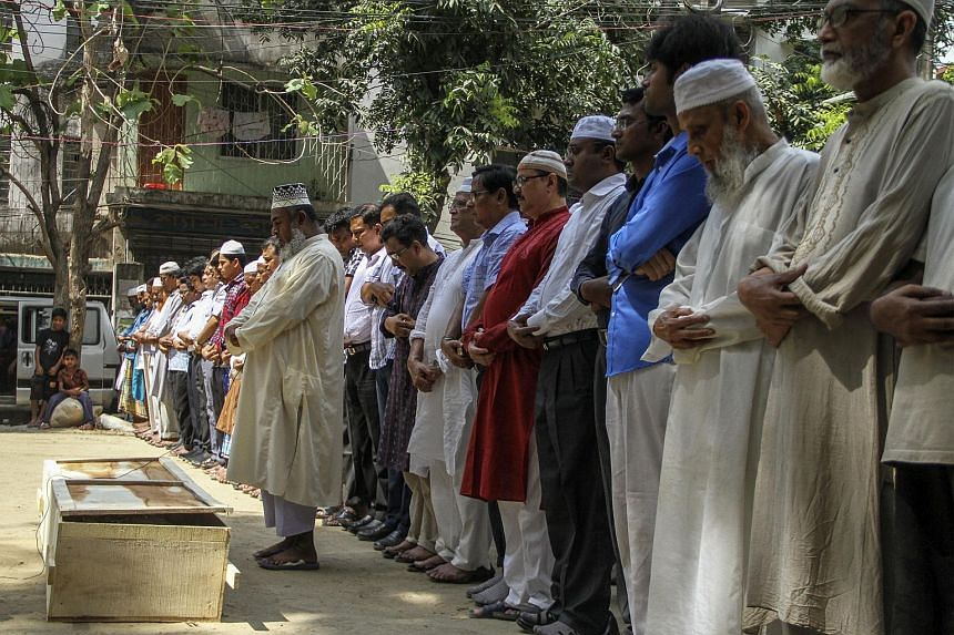 Relatives and friends attend the funeral prayer of Bangladeshi activist Xulhaz Mannan in Dhaka, on April 26, 2016.