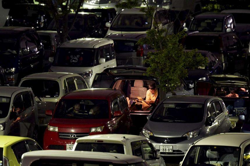 Evacuees spending the night inside their cars in Kumamoto, Japan, on April 20, 2016.