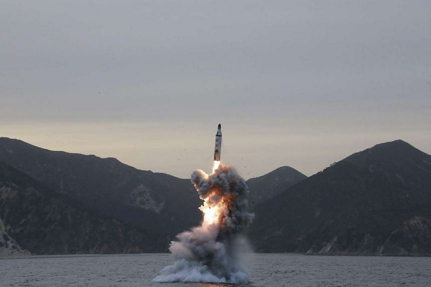 """An """"underwater test-fire of strategic submarine ballistic missile"""" conducted at an undisclosed location in North Korea, released by KCNA."""