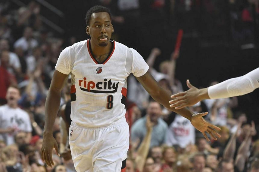 Portland Trail Blazers' Al-Farouq Aminu celebrates after hitting a three point shot in Game 4 of the Western Conference quarter-finals against the Los Angeles Clippers on April 25, 2016.